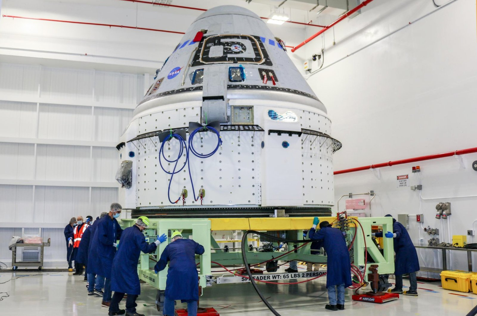 Technicians prepare Boeing's CST-100 Starliner for the company's Orbital Flight Test-2 (OFT-2) in the Commercial Crew and Cargo Processing Facility at NASA's Kennedy Space Center in Florida, U.S., June 2, 2021. (NASA via AP)