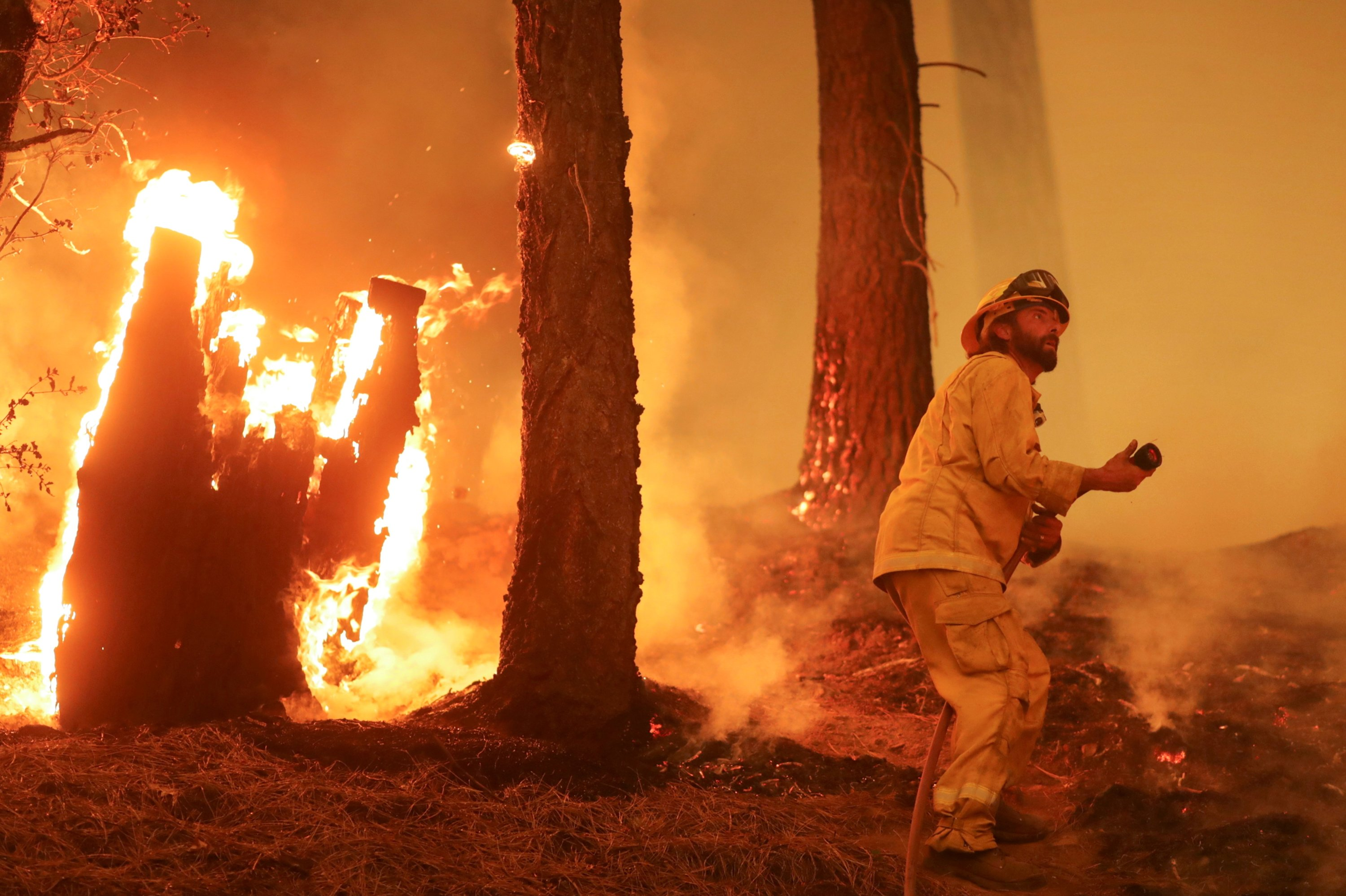 A firefighter continues to hold the line of the Dixie Fire near Taylorsville, California, U.S., Aug. 10, 2021. (Reuters Photo)