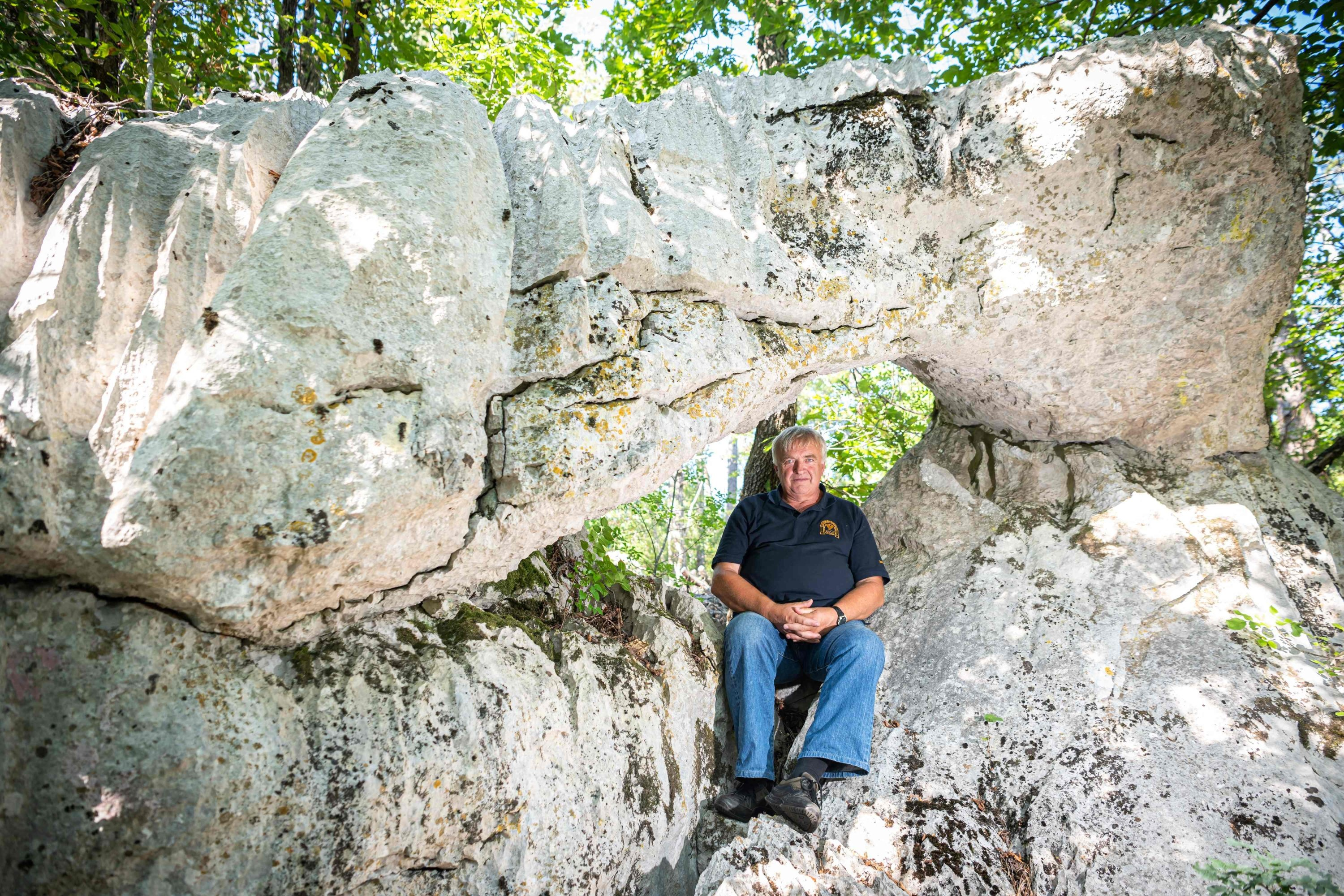 Caver Ludvik Husu, who uncovered several caves in the Karst area, poses near Sezana, Slovenia, Aug. 7, 2021. (AFP Photo)