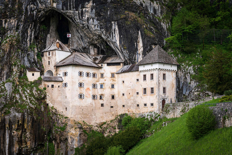 The Predjama Castle, a Renaissance construction built within a cave mouth, can be seen near Postojna, Slovenia, May 25, 2021. (AFP Photo)
