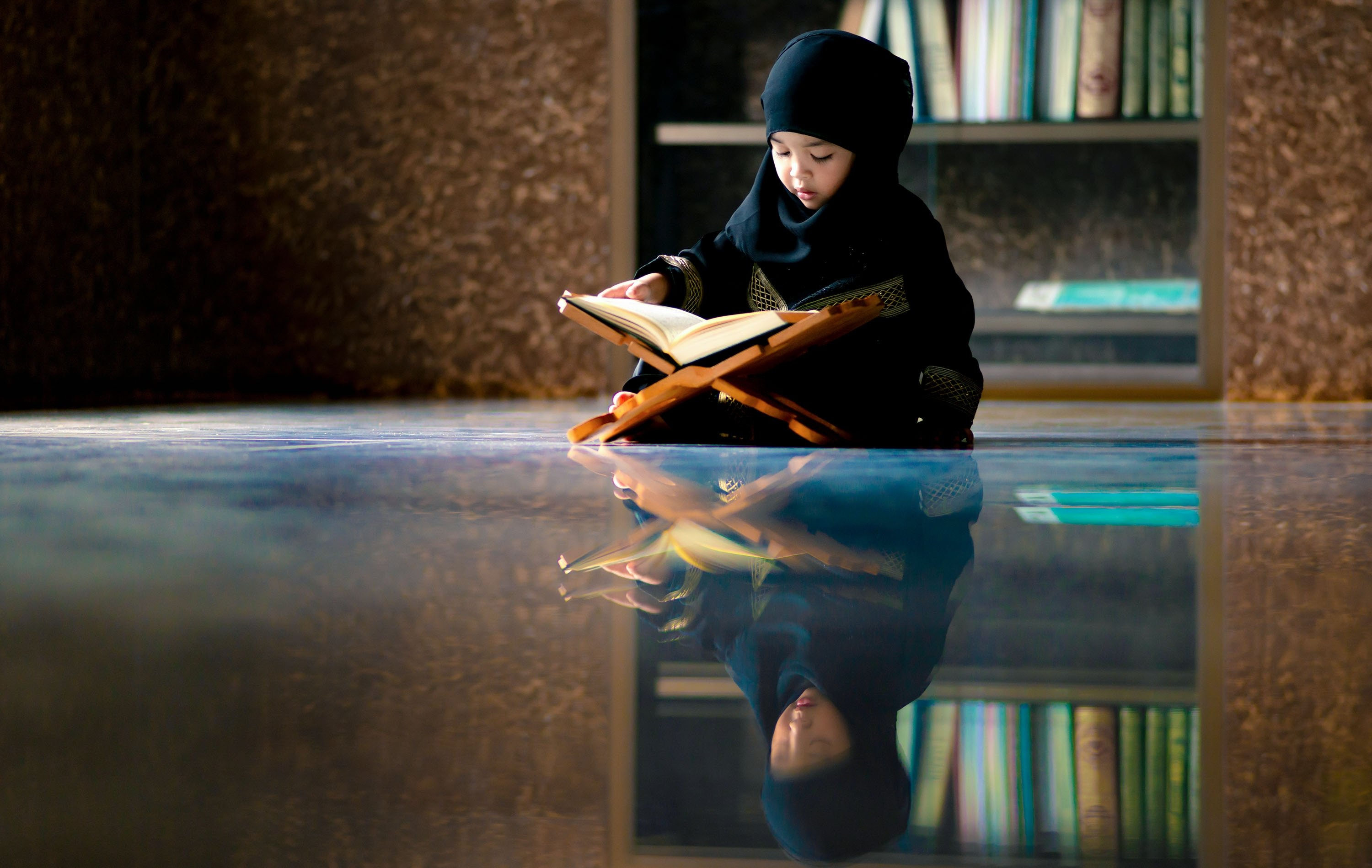 A little girl reads the Quran, the holy book of Islam. (Shutterstock Photo)
