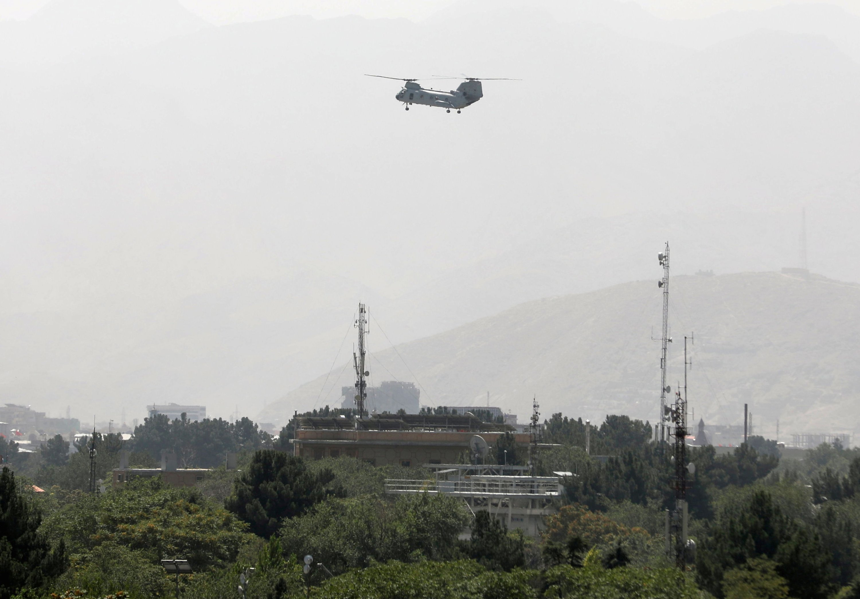 CH-46 Sea Knight military transport helicopter flies over Kabul, Afghanistan, Aug. 15, 2021. (REUTERS Photo)