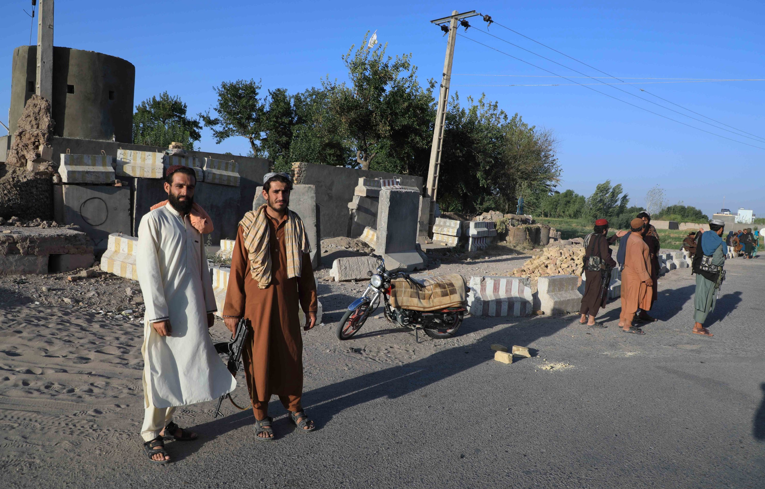 Taliban stand guard at a checkpoint as they took control of Herat, Afghanistan, Aug. 15, 2021. (EPA Photo)