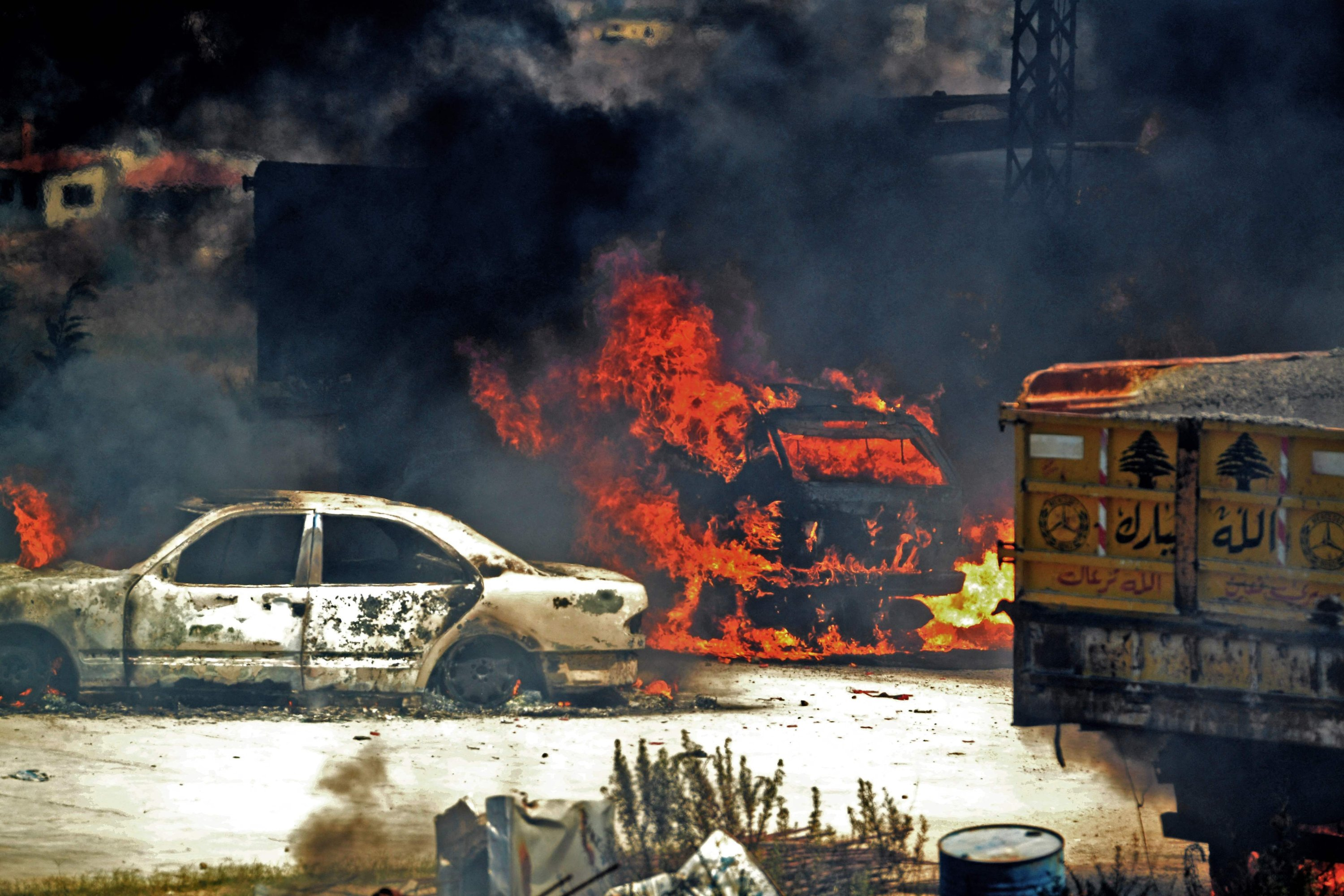 Vehicles burn outside the reported home of the lot owner, where the exploded fuel tank was placed, in the village of Tlel in Lebanon's northern region of Akkar, Aug. 15, 2021. (AFP Photo)