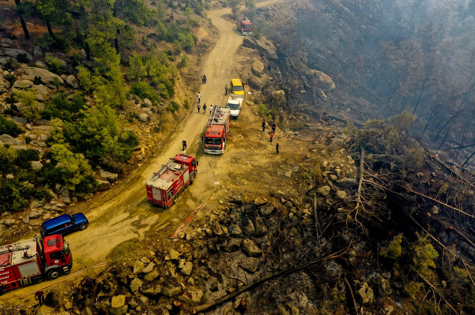Firefighting teamsrush to fields destroyed by wildfires as part of the campaign to fight the nationwide disaster, Manavgat, Antalya, southern Turkey, Aug. 4, 2021. (AA Photo)