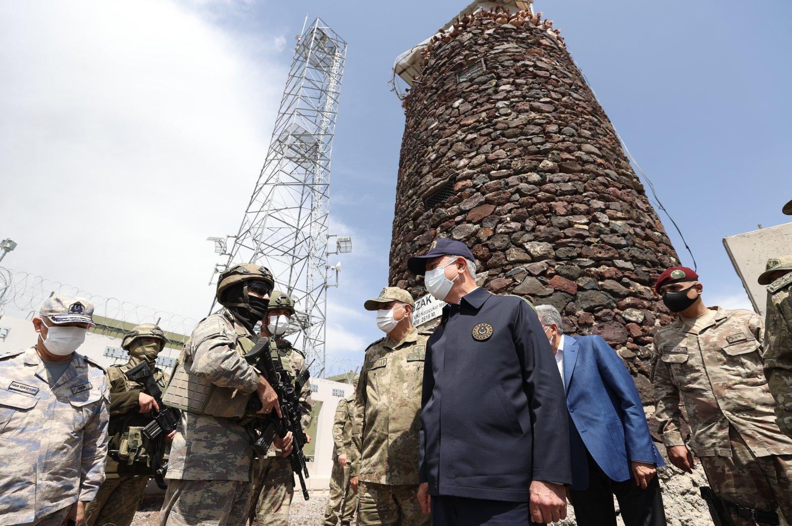 Defense Minister Hulusi Akar is inspecting the measures taken on the Turkey-Iran border, Aug. 14, 2021 (AA Photo)