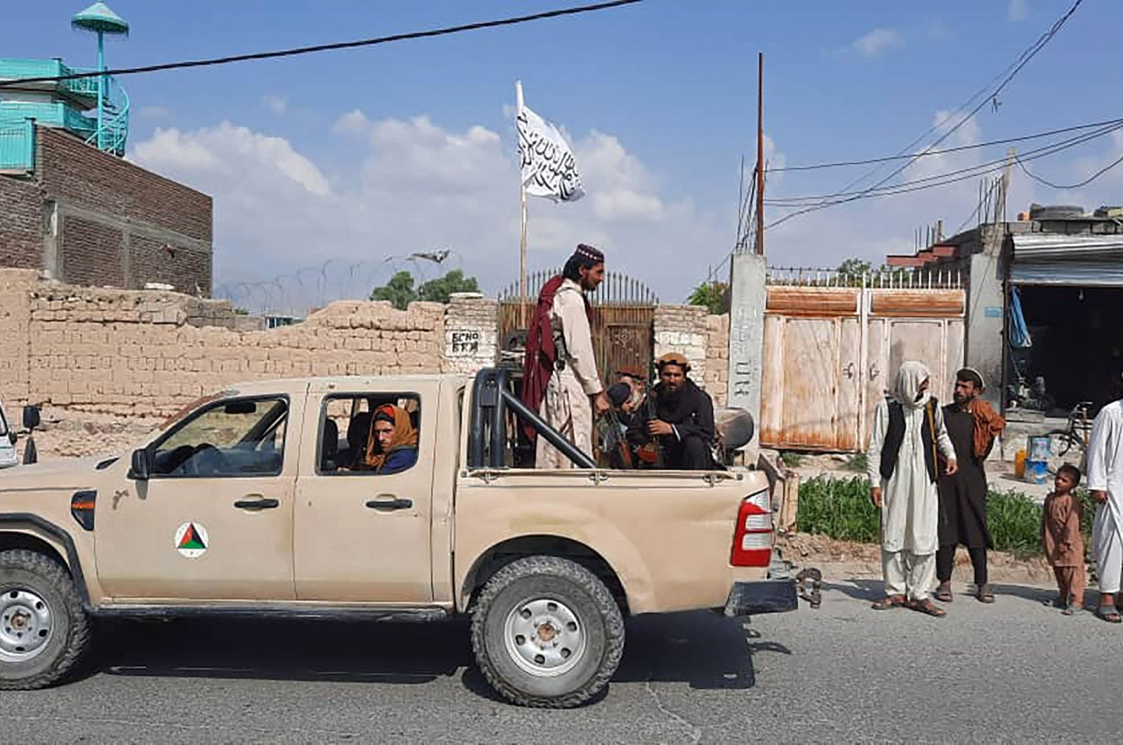 Taliban fighters drive an Afghan National Army (ANA) vehicle through the streets of Laghman province, Afghanistan, on Aug. 15, 2021. (AFP Photo)