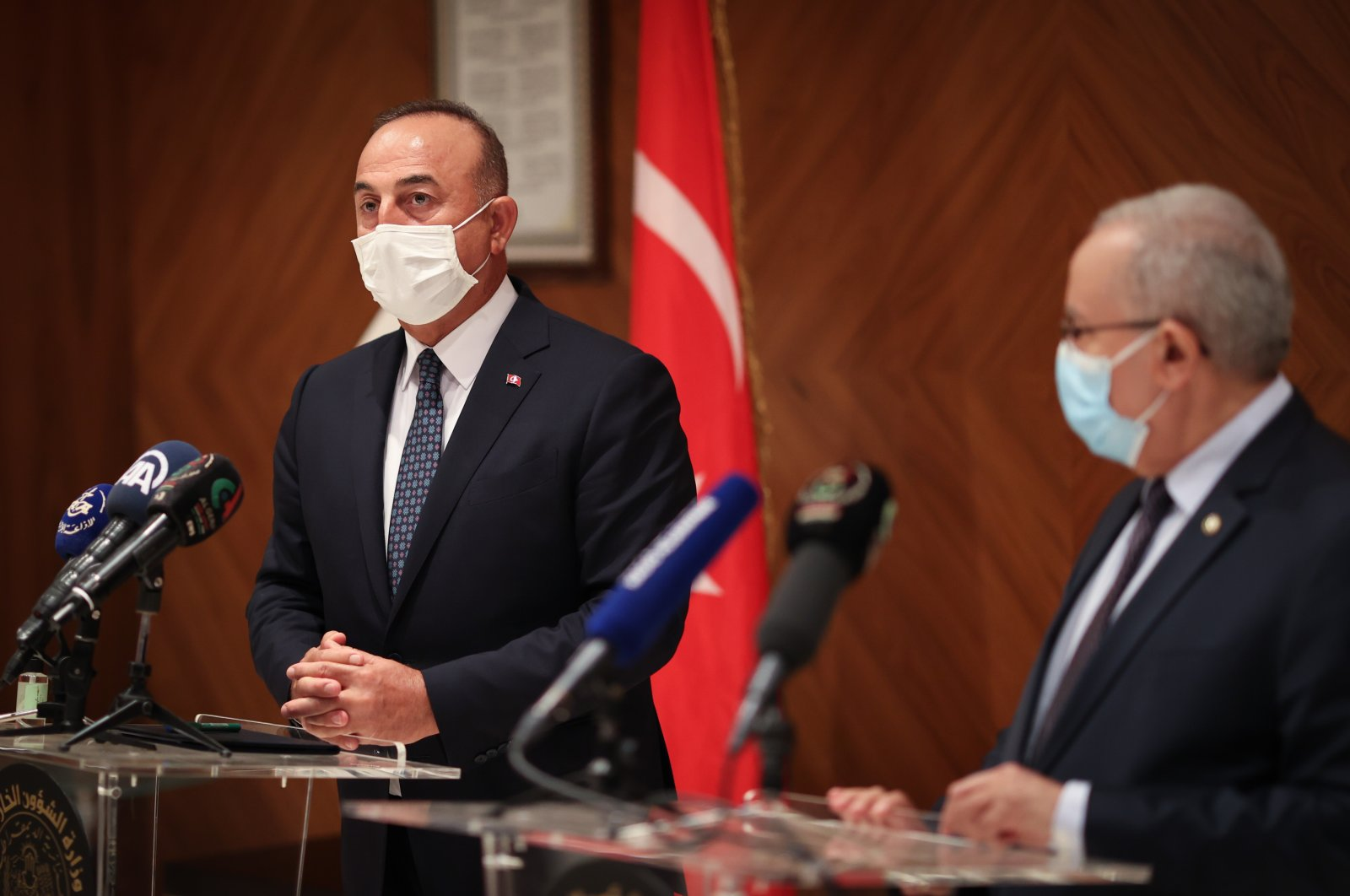 Foreign Minister Mevlüt Çavuşoğlu (L) speaks at a joint press conference with his Algerian counterpart Ramtane Lamamra in Algeria, Aug. 14, 2021. (AA Photo)
