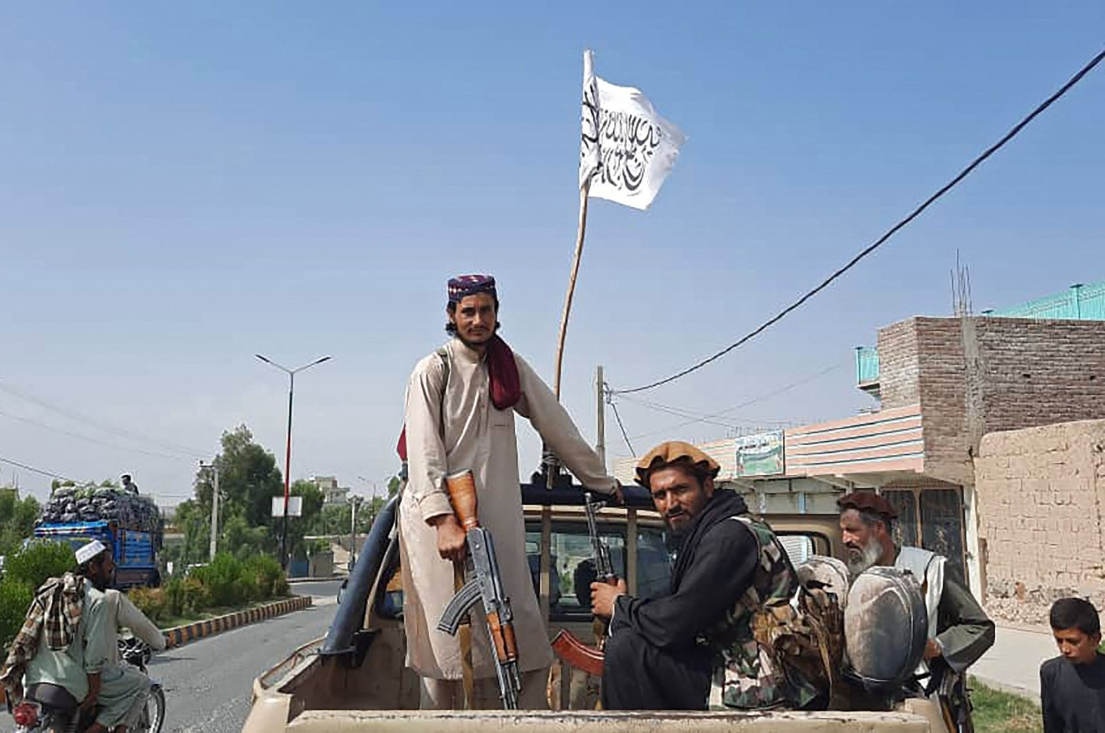 Taliban fighters drive an Afghan National Army (ANA) vehicle through the streets of Laghman province, Afghanistan, Aug. 15, 2021. (AFP Photo))