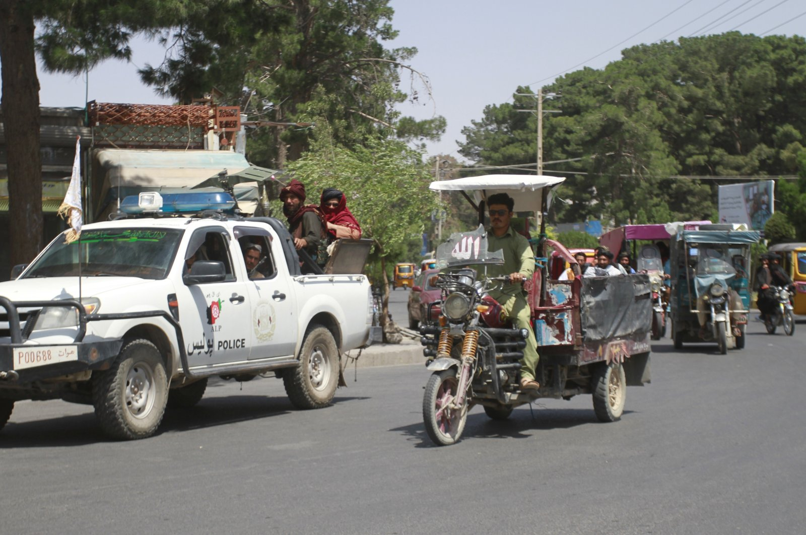 Members of the Taliban, left, drive with other motorists through city of Herat, Afghanistan, west of Kabul, Saturday, Aug. 14, 2021, after the province was taken from the Afghan government. (AP Photo)