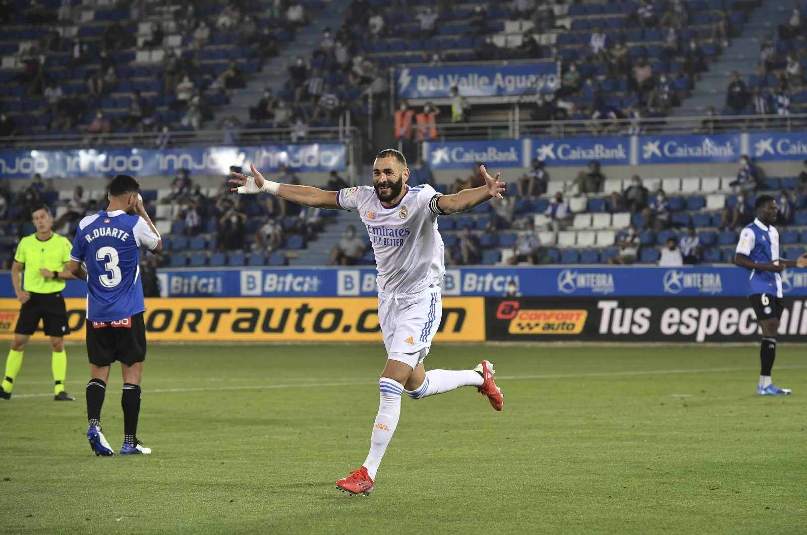 Real Madrid's Karim Benzema celebrates scoring his side's third goal during a Spanish La Liga match against Alaves at the Mendizorroza stadium in Vitoria, Spain, Aug. 14, 2021. (AP Photo)