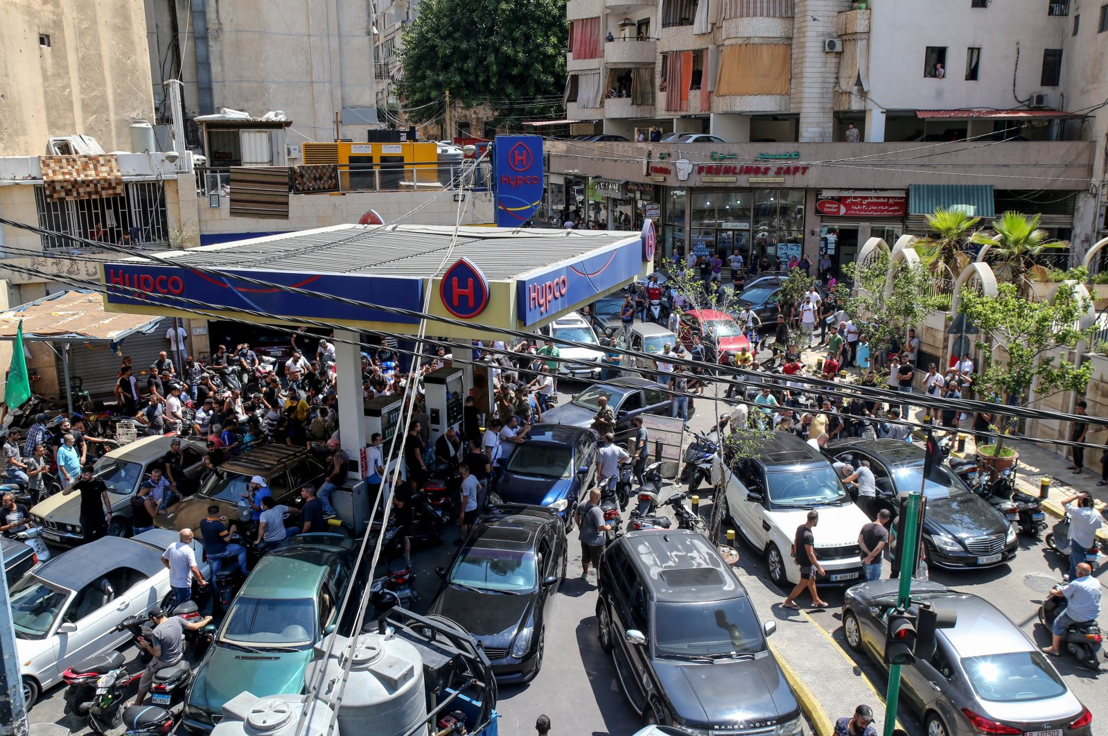 Motorcyclists and cars gather inside a gasoline station after security forces raided and ordered the station owner to distribute gasoline to citizens, in Beirut, Lebanon, Aug. 14, 2021. (EPA Photo)