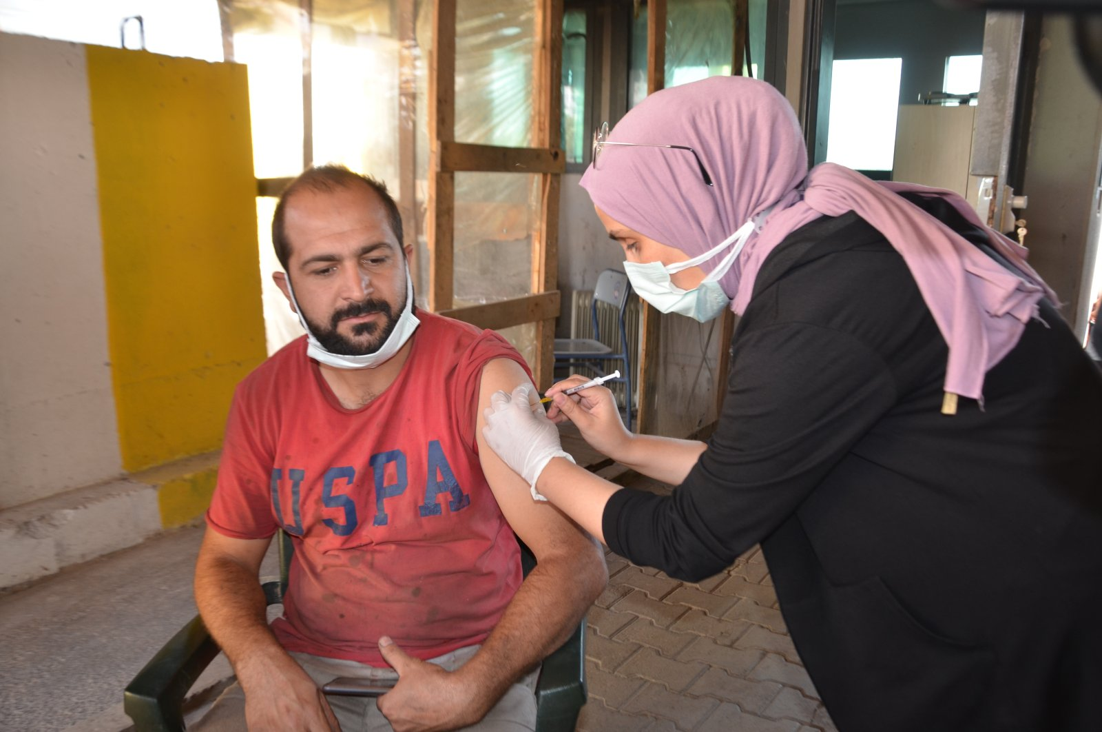 A man gets vaccinated in Muş, eastern Turkey, Aug. 15, 2021. (AA PHOTO)