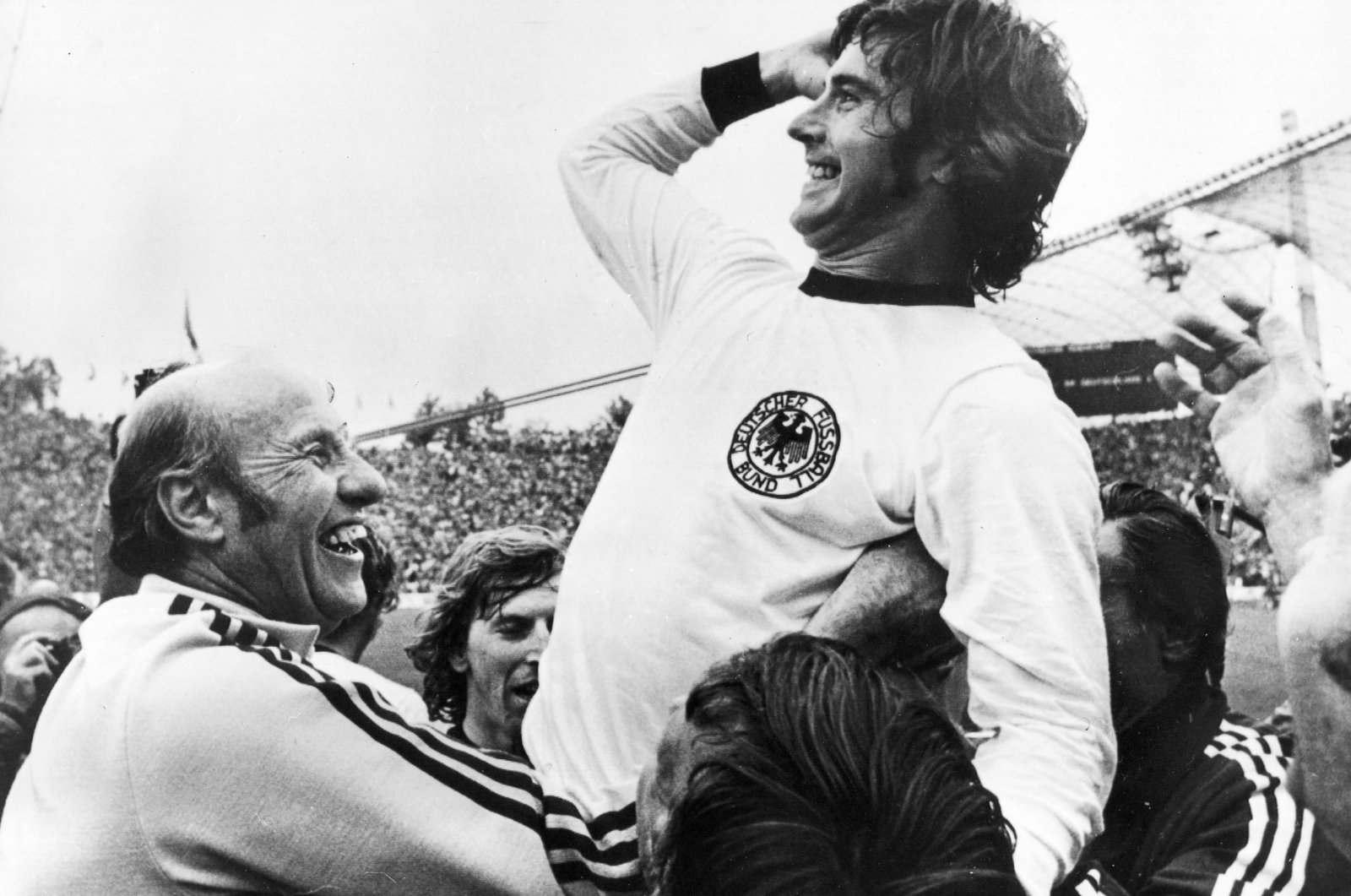 GerdMuller(R)celebrating with German head coach Helmut Schoen (L)after winning the FIFA1974 World Cup final against the Netherlands in Munich, Germany, July 7, 1974. (EPA Photo)