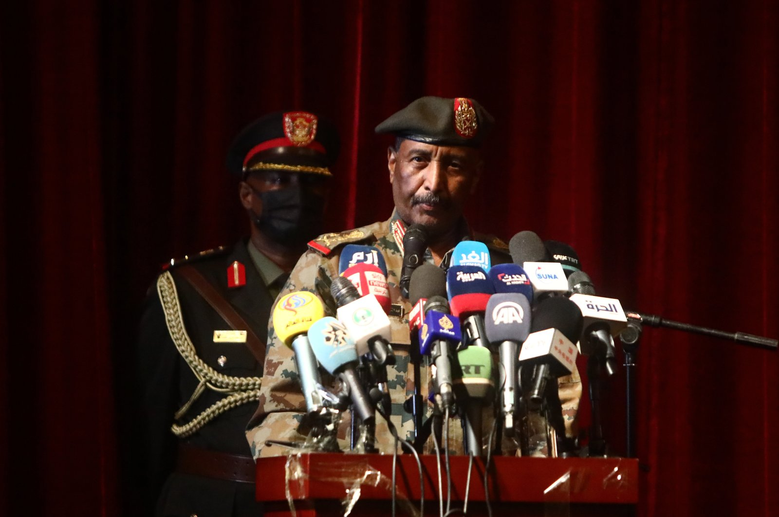 Abdel Fattah al-Burhan, the chairperson of the country's Sovereign Council, speaks at a conference in Khartoum, Sudan, Aug.15, 2021. (AA Photo)