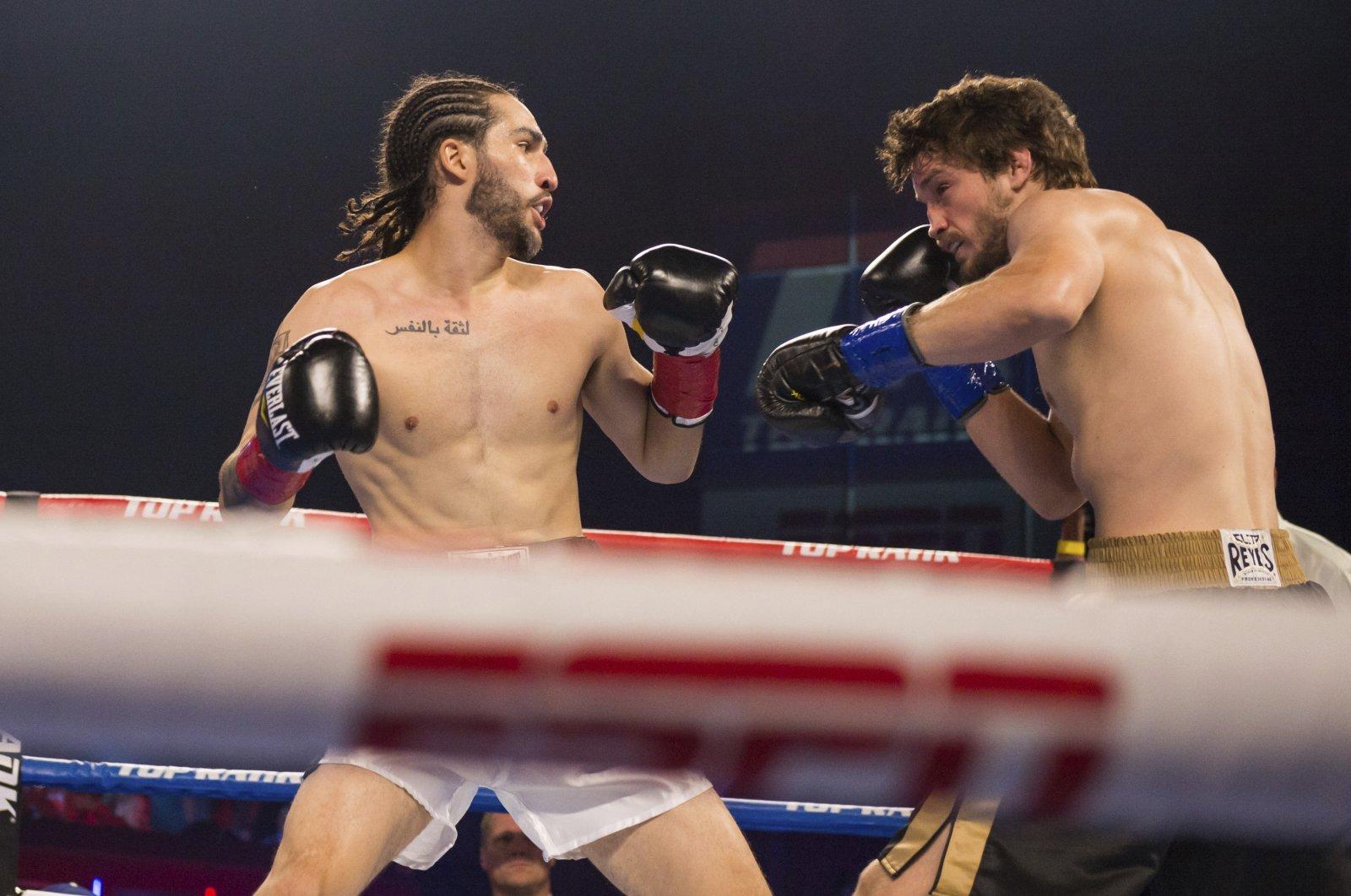 Nico Ali Walsh (L) faces Jordan Weeks during a middleweight boxing bout, Tulsa, Oklahoma, U.S., Aug. 14, 2021. (AP Photo)