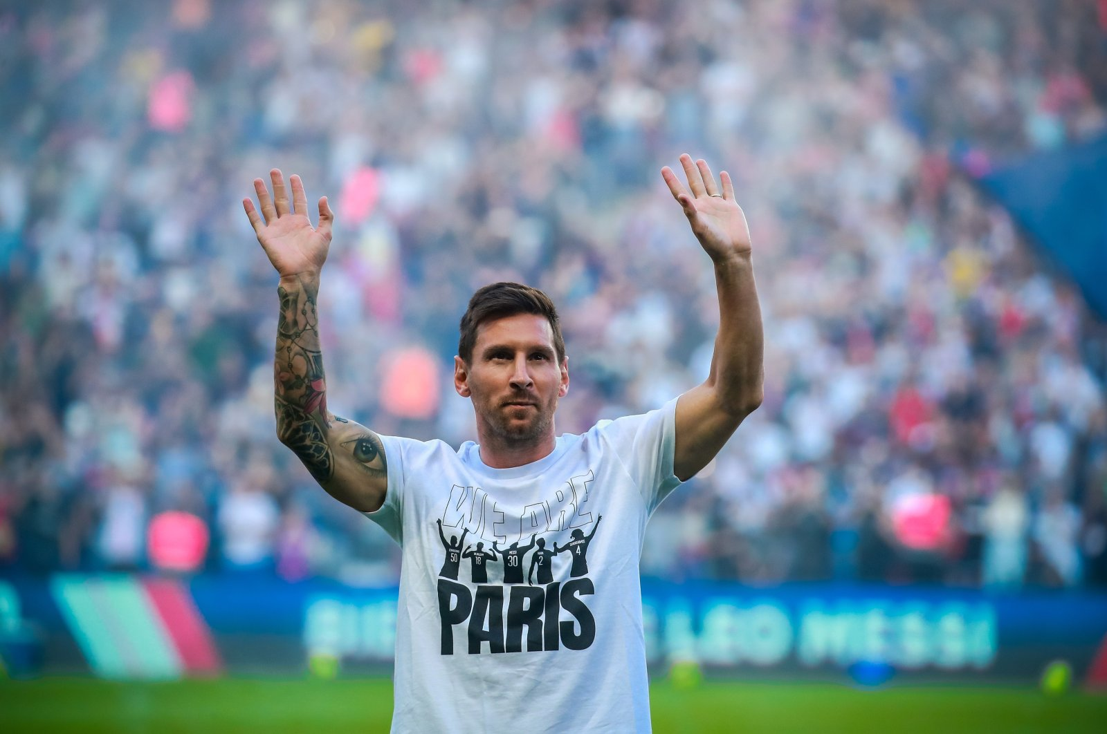 Paris Saint-Germain's Lionel Messi greets fans during the presentation of the new recruits prior to the French Ligue 1 match against Strasbourg at the Parc des Princes stadium, Paris, France, Aug. 14, 2021. (EPA Photo)