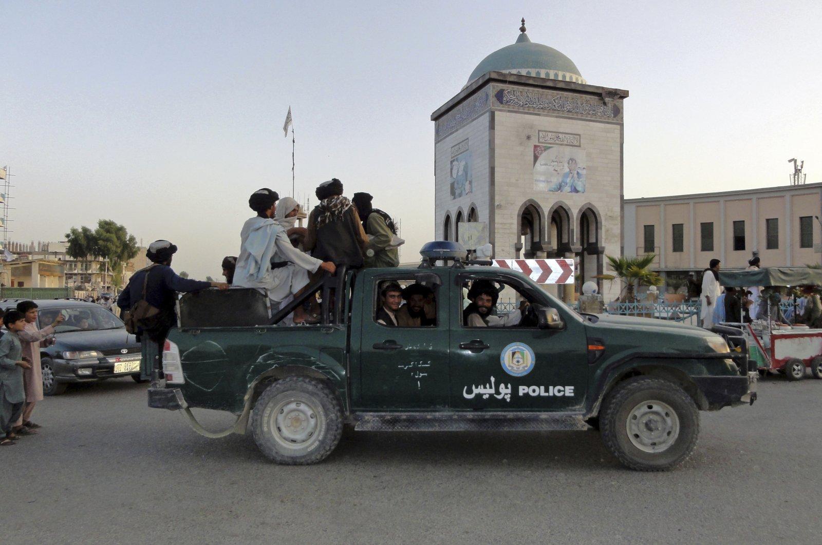 Taliban fighters patrol inside the city of Kandahar, southwest Afghanistan, Aug. 15, 2021. (AP Photo)