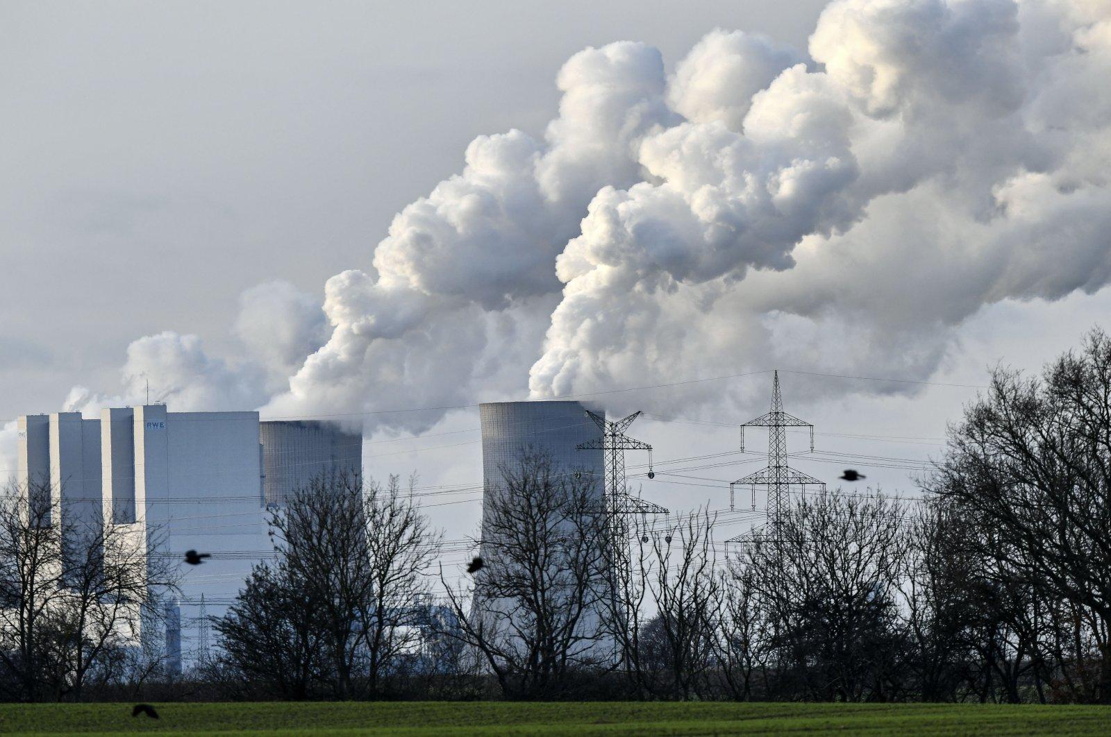 The RWE Niederaussem lignite-fired power station steams in Bergheim, Germany, Jan. 13, 2020. (AP Photo)