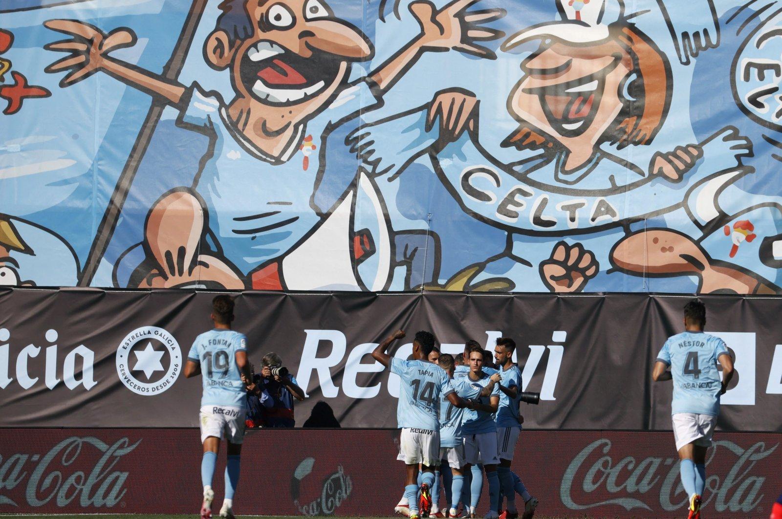 Celta de Vigo's players celebrate after scoring the 1-1 goal during a Spanish LaLiga soccer match between Celta de Vigo and Atletico Madrid at Balaidos stadium in Vigo, Galicia, Spain, Aug. 15, 2021. (EPA Photo)