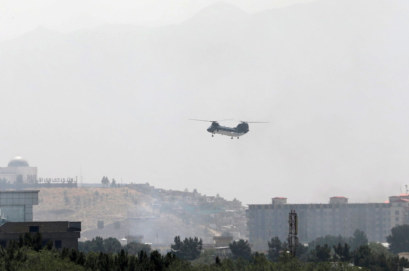 Sea Knight military transport helicopter flies over Kabul, Afghanistan Aug.15, 2021. (Reuters Photo)