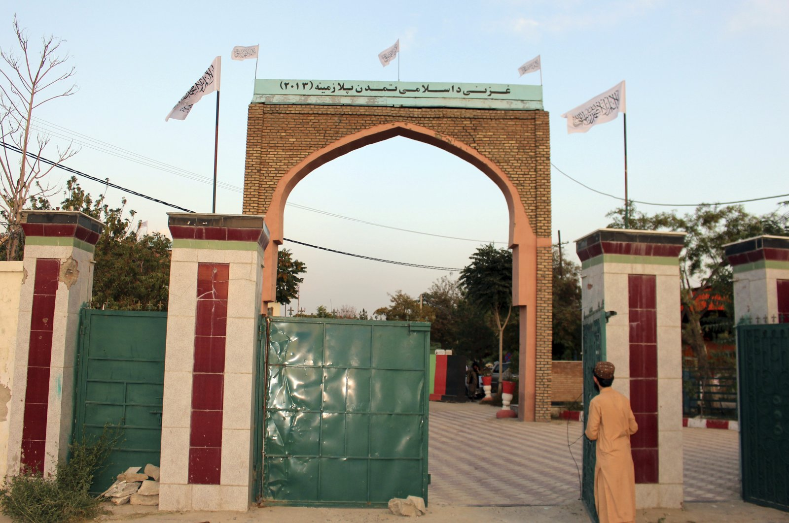 Taliban flags fly on the gate of Ghazni provincial governor's house, in Ghazni, southeastern, Afghanistan, Aug. 15, 2021. (AP Photo)