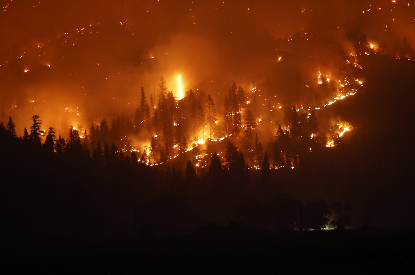 The Dixie fire burns the forest in the mountains as seen from Taylorsville, California, U.S., Aug. 13, 2021. (EPA Photo)