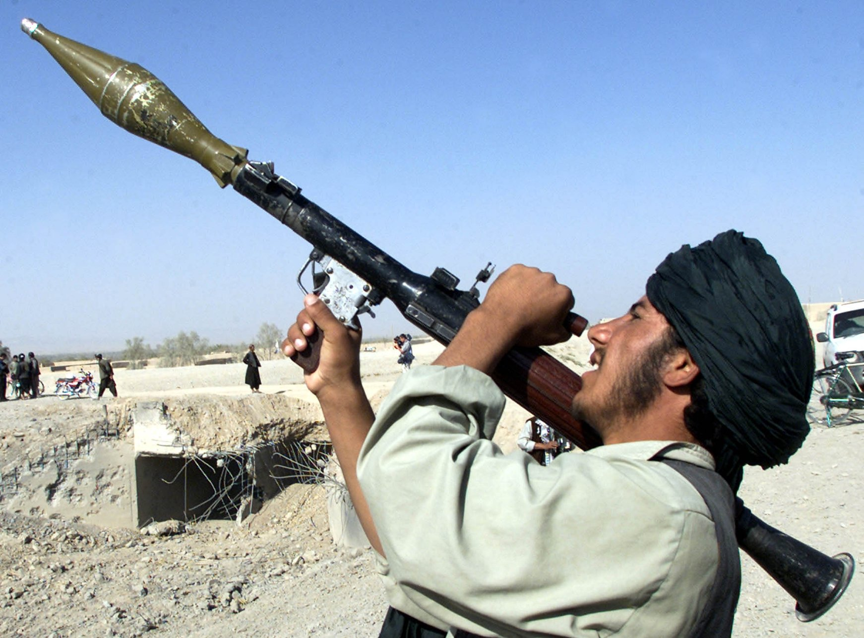 Taliban tar alleged thief, fire at crowds and walk streets with rocket launchers