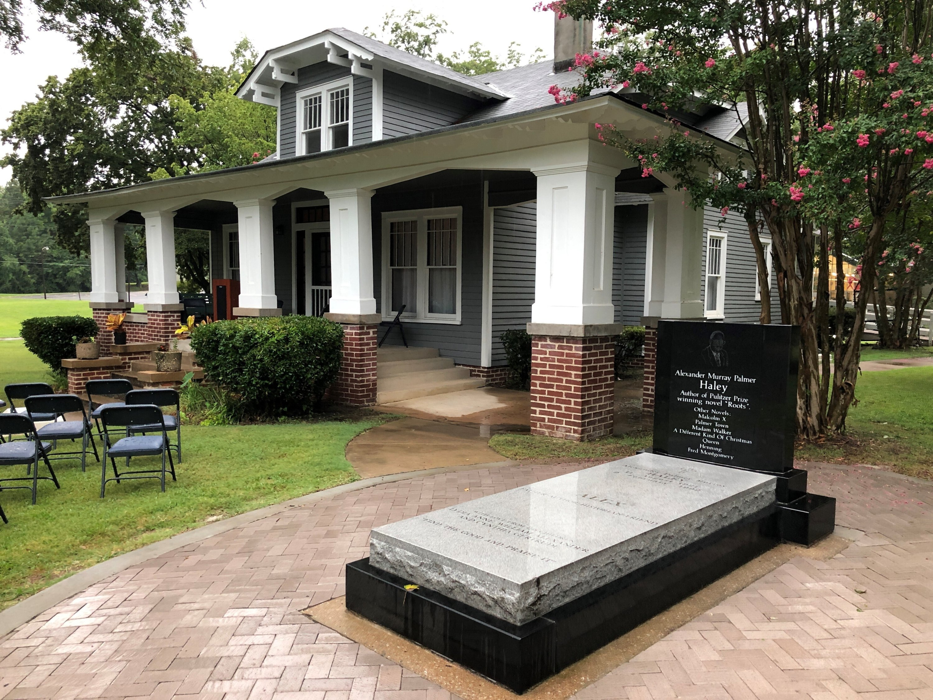 The grave of late author Alex Haley sits outside his former boyhood home in Henning, Tennessee, U.S., Aug. 13, 2021. (AP Photo)