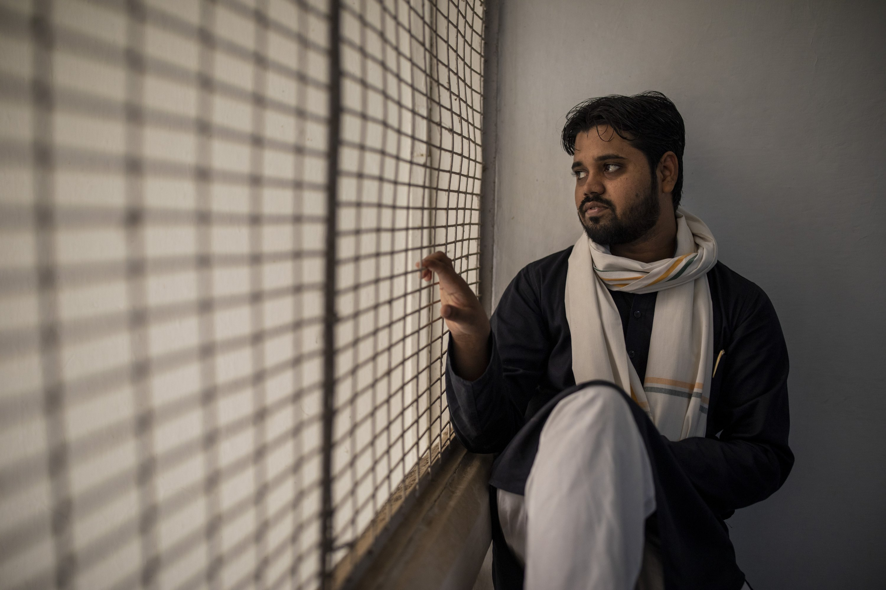 Asif Iqbal Tanha, 24, a student leader, looks out from a window at the Students Islamic Organisation of India headquarters in New Delhi, India, on Aug. 3, 2021. (AP Photo)