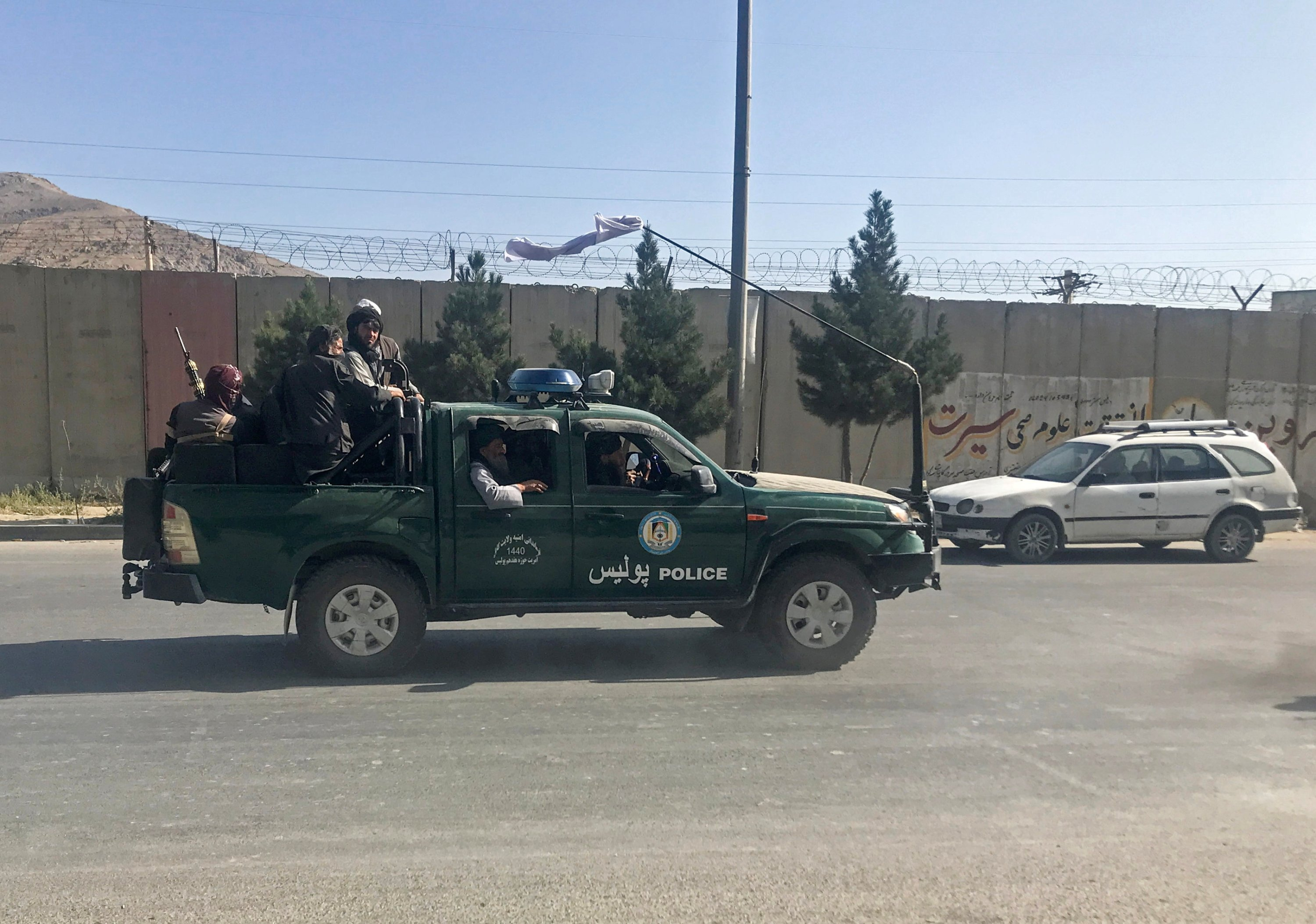 Taliban fighters ride on a police vehicle in Kabul, Afghanistan, Aug. 16, 2021. (REUTERS Photo)