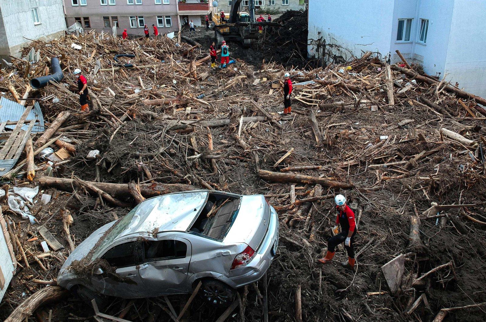 Rescuers look through the debris following flash floods in Bozkurt, in Kastamonu, northern Turkey, Aug. 15, 2021. (AFP Photo)