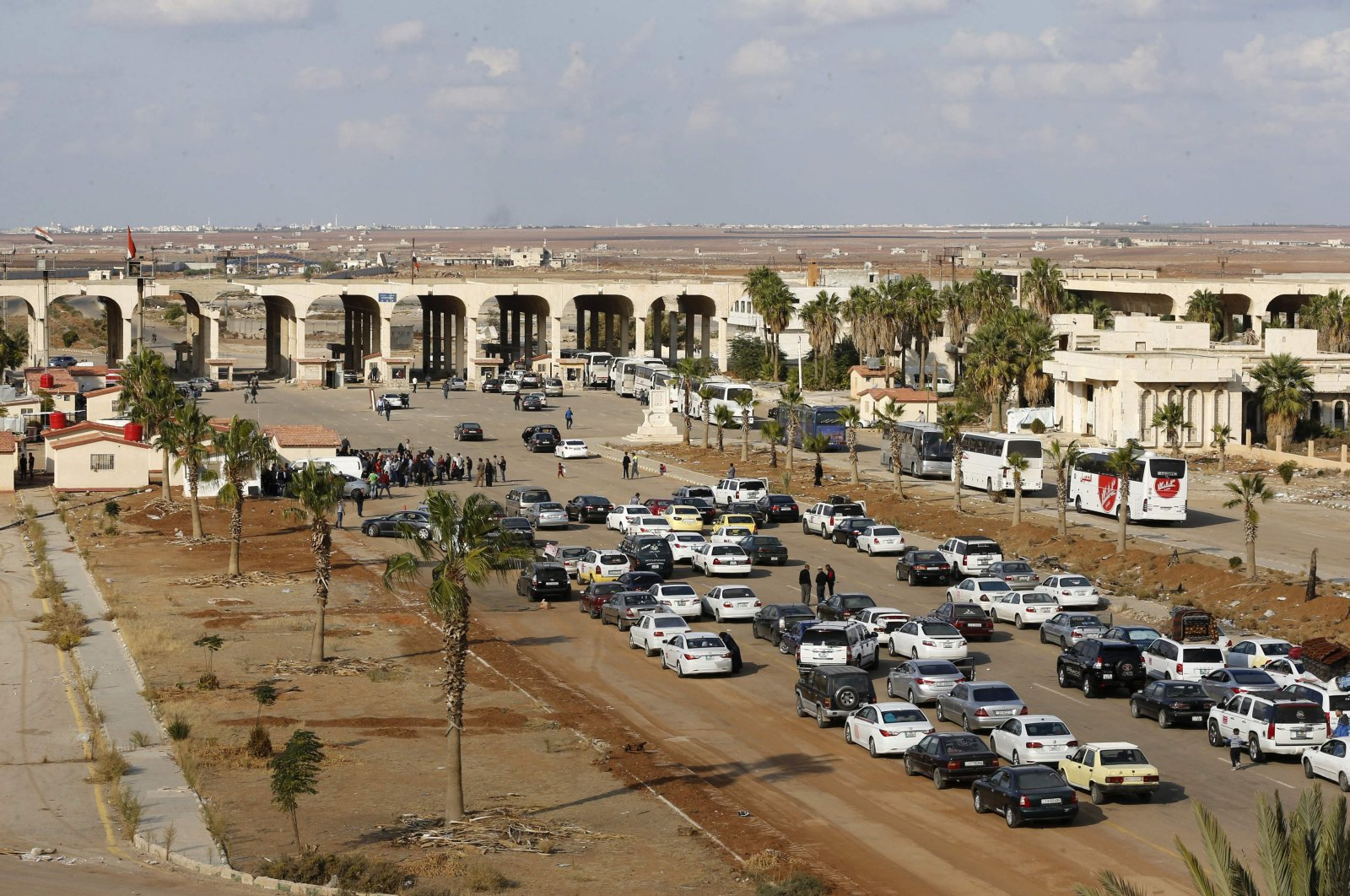 Vehicles wait to cross into Syria at the recently reopened Nassib/Jaber border post in Daraa province, at the Syrian-Jordanian border south of Damascus, Nov. 7, 2018 (AFP File Photo)