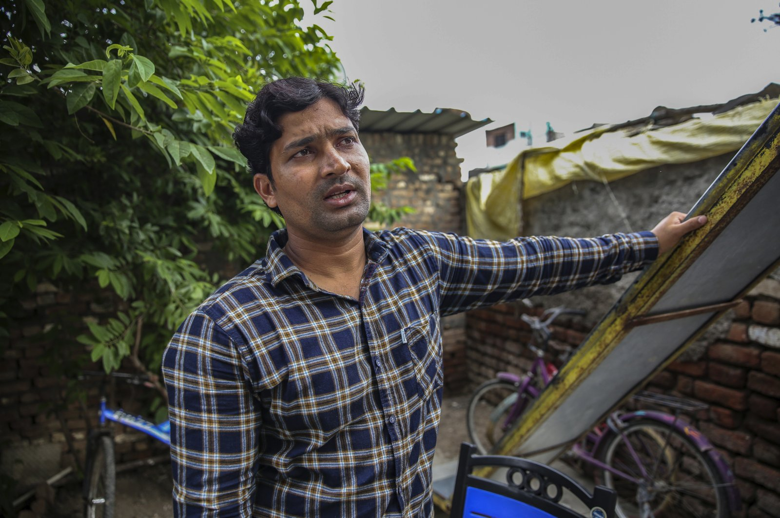 Mohammed Irfan, 24, stands outside his home in Nanded, Maharashtra state, India, on Aug. 3, 2021. (AP Photo)