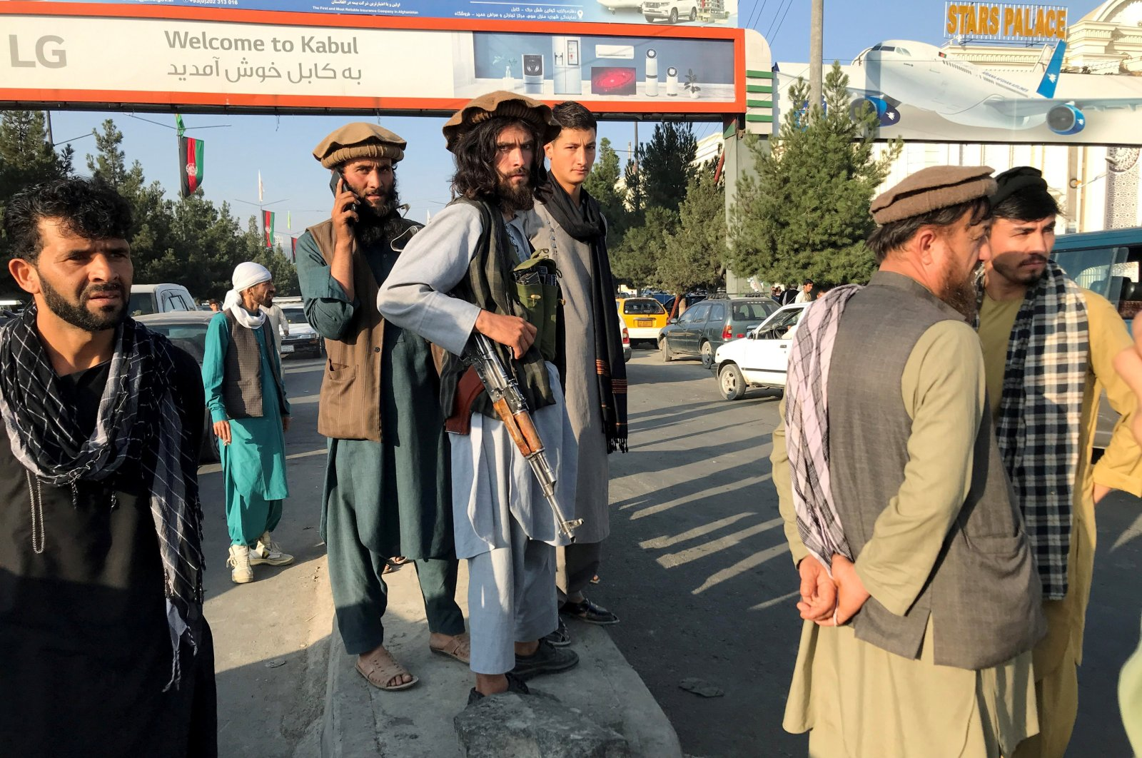 Taliban fighters stand outside Hamid Karzai International Airport in Kabul, Afghanistan, Aug. 16, 2021. (Reuters Photo)