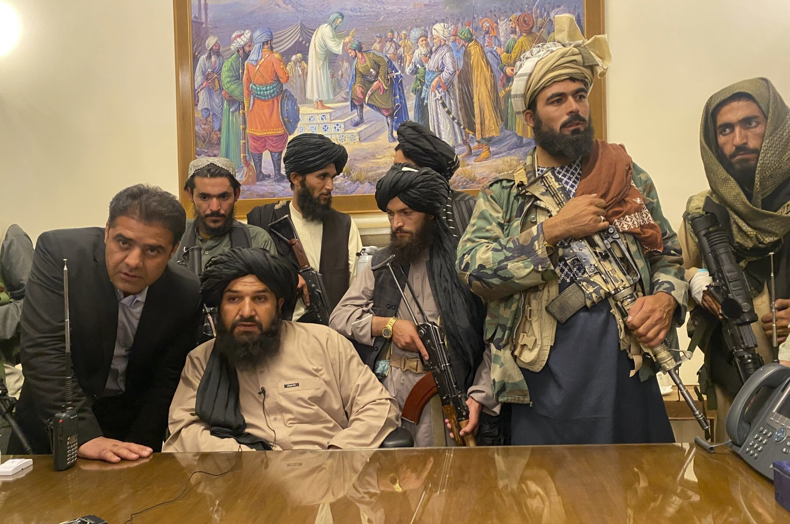 Taliban fighters take control of the Afghan presidential palace after Afghan President Ashraf Ghani fled the country, in Kabul, Afghanistan, Aug. 15, 2021. (AP Photo)