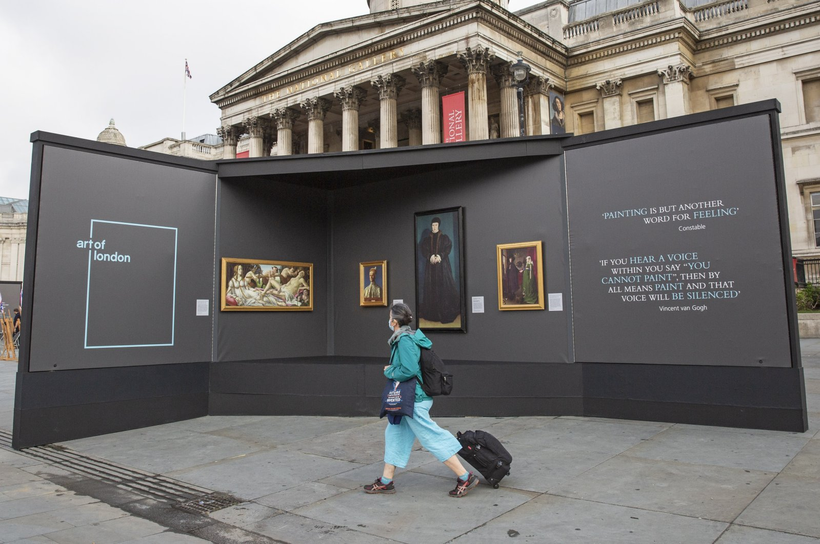 A member of the public visits an outdoor gallery in Trafalgar Square, London, as part of the Inside Out festival. (DPA Photo)