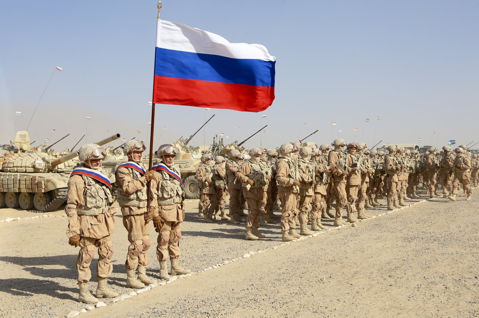 Russian troops line up before the start of joint military drills by Tajikistan and Uzbekistan at Harb-Maidon firing range about 20 kilometers (about 12 miles) north of the Tajik border with Afghanistan, in Tajikistan, Aug. 10, 2021. (AP Photo)