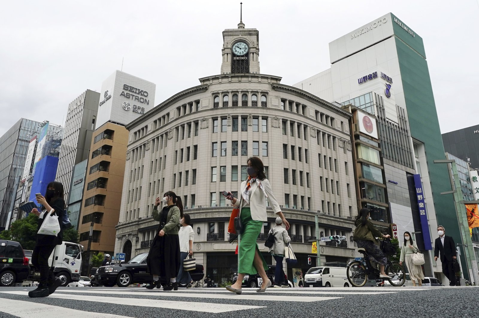 People wearing protective masks to help curb the spread of the coronavirus walk at Ginza shopping district, in Tokyo, Japan, May 11, 2021. (AP Photo)