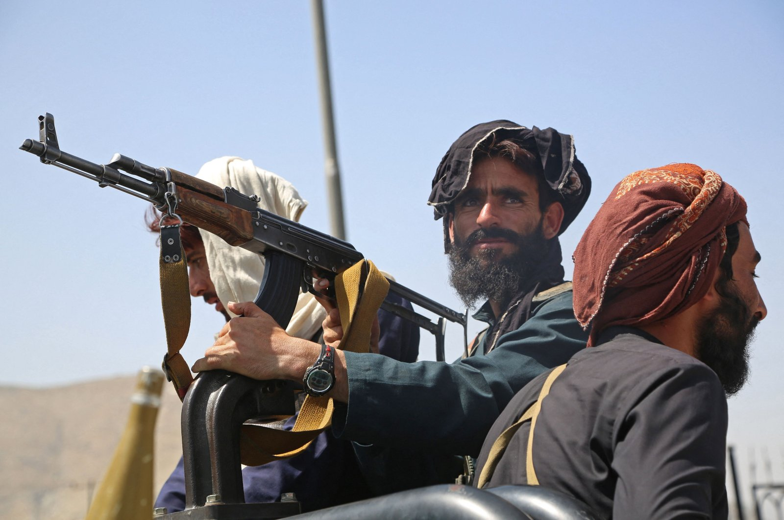 Taliban fighters stand guard in a vehicle along the roadside after a stunningly swift end to Afghanistan's 20-year war, as thousands of people mobbed the city's airport trying to flee the group's feared hardline brand of rule, Kabul, Afghanistan, Aug. 16, 2021. (AFP Photo)