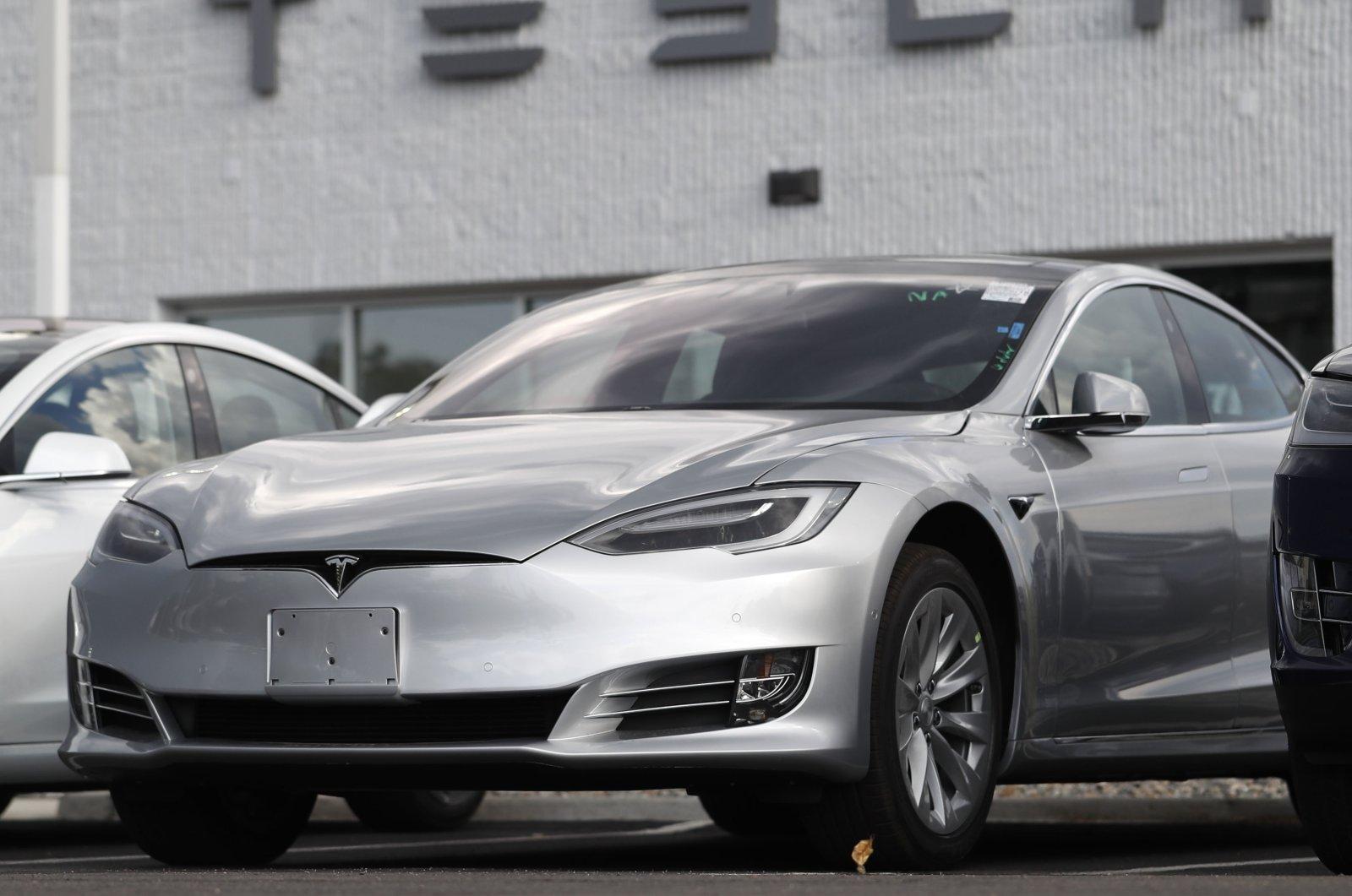 Tesla 2018 Model 3 sedans sits on display outside a Tesla showroom in Littleton, Colorado, U.S., July 8, 2018. (AP Photo)