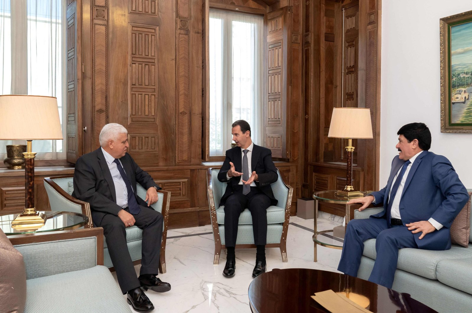 Syria's Bashar Assad (C) receives Faleh Fayyad (L), the chairman of the Iraqi Popular Mobilization Forces, in Damascus, Syria, Aug. 16, 2021. (AFP Photo)