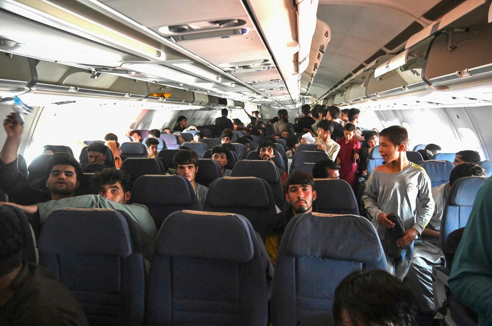 Afghan passengers sit inside a plane as they wait to leave Kabul Hamid Karzai International Airport, Kabul, Afghanistan, Aug. 16, 2021. (AFP Photo)