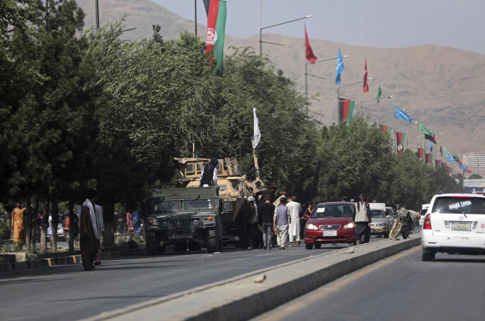 Taliban fighters stand guard on the road leading to the Hamid Karzai International Airport, in Kabul, Afghanistan, Aug. 16, 2021. (AP Photo)