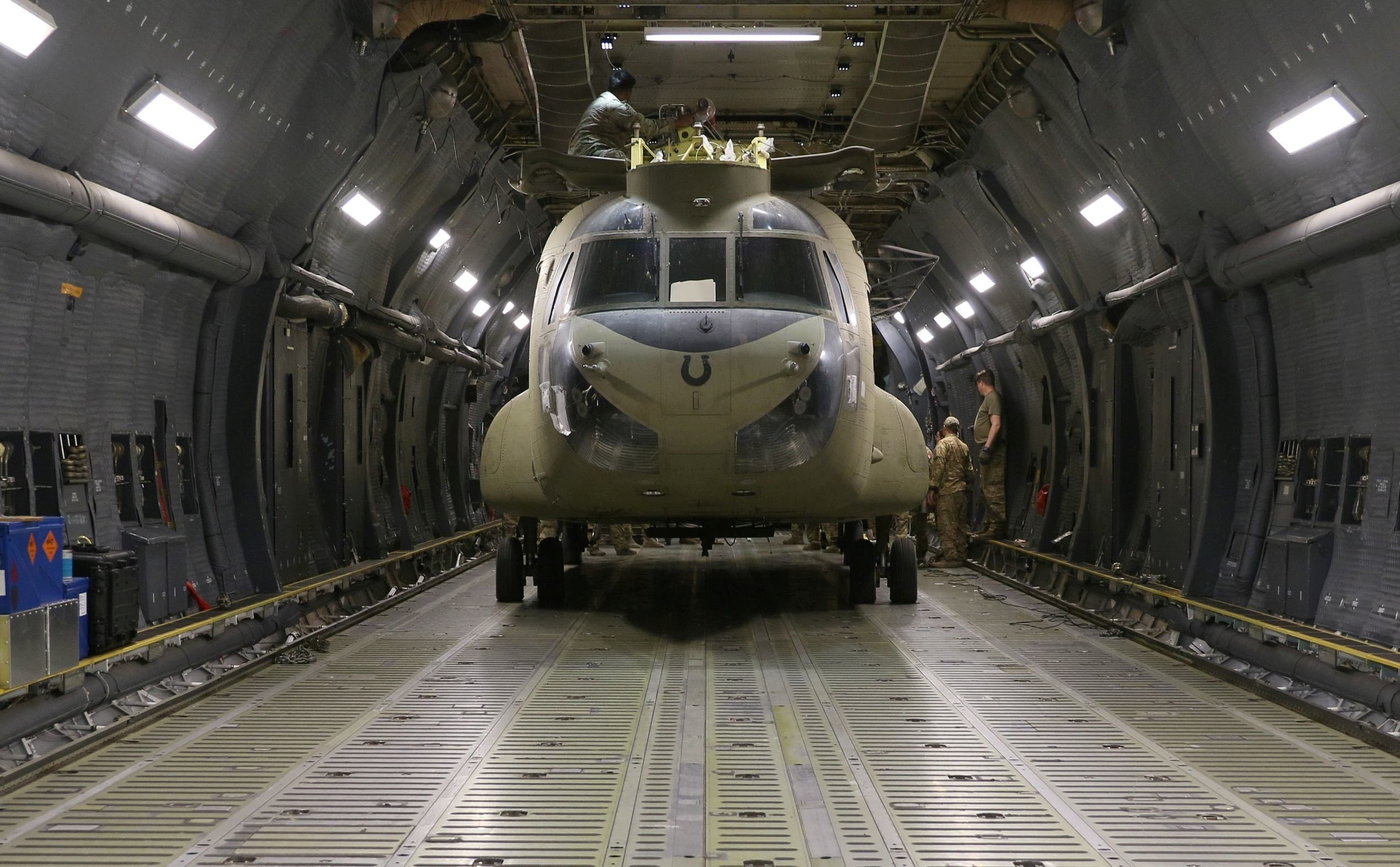 Aerial porters work with maintainers to load a CH-47 Chinook helicopter into a U.S. Air Force C-17 Globemaster III during the withdrawal of American forces from Afghanistan, June 16, 2021. (Reuters Photo)