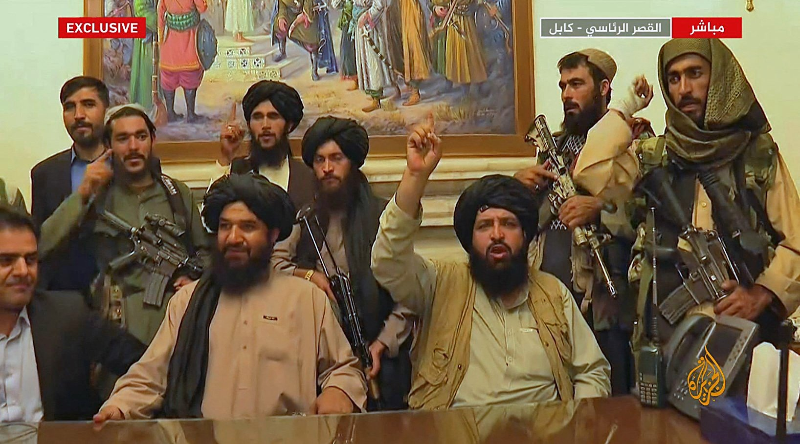 An image grab taken from Qatar-based Al-Jazeera television on Aug. 16, 2021, shows members of the Taliban taking control of the presidential palace in Kabul after Afghanistan's president flew out of the country. (AFP Photo/HO/Al Jazeera)