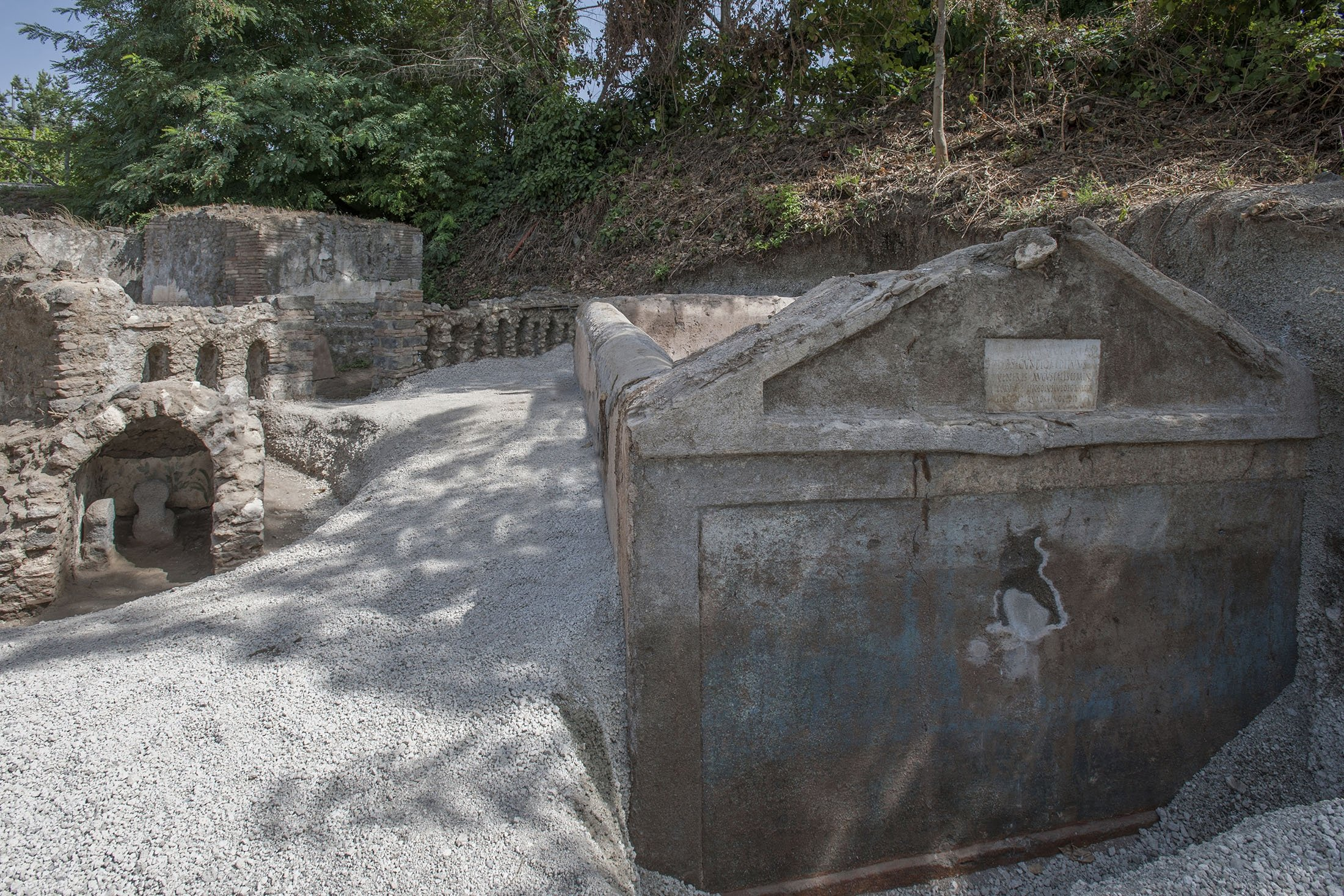 A view of the tomb of Marcus Venerius Secundio located in the necropolis of Porta Sarno can be seenin an area not yet open to the public in the east of Pompeii's urban center, Pompeii, Italy. (Pompeii Archeological Park via AP)