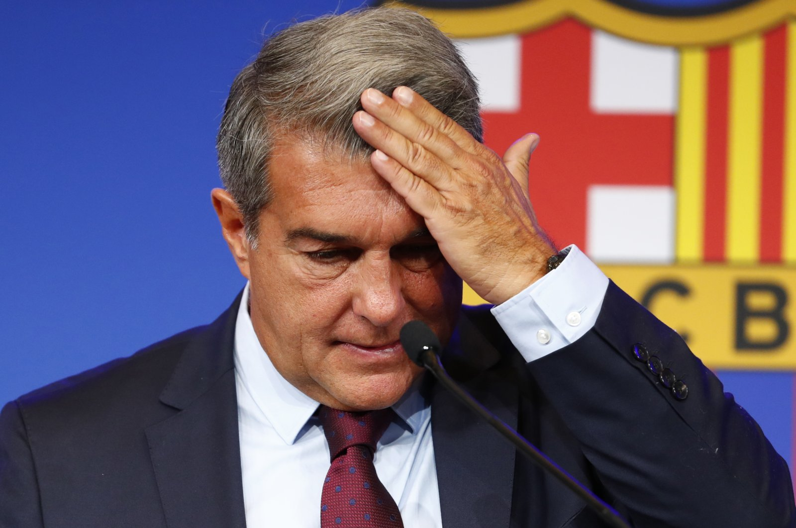 Barcelona club President Joan Laporta begins a news conference in Barcelona, Spain, Friday, Aug. 6, 2021. (AP Photo)
