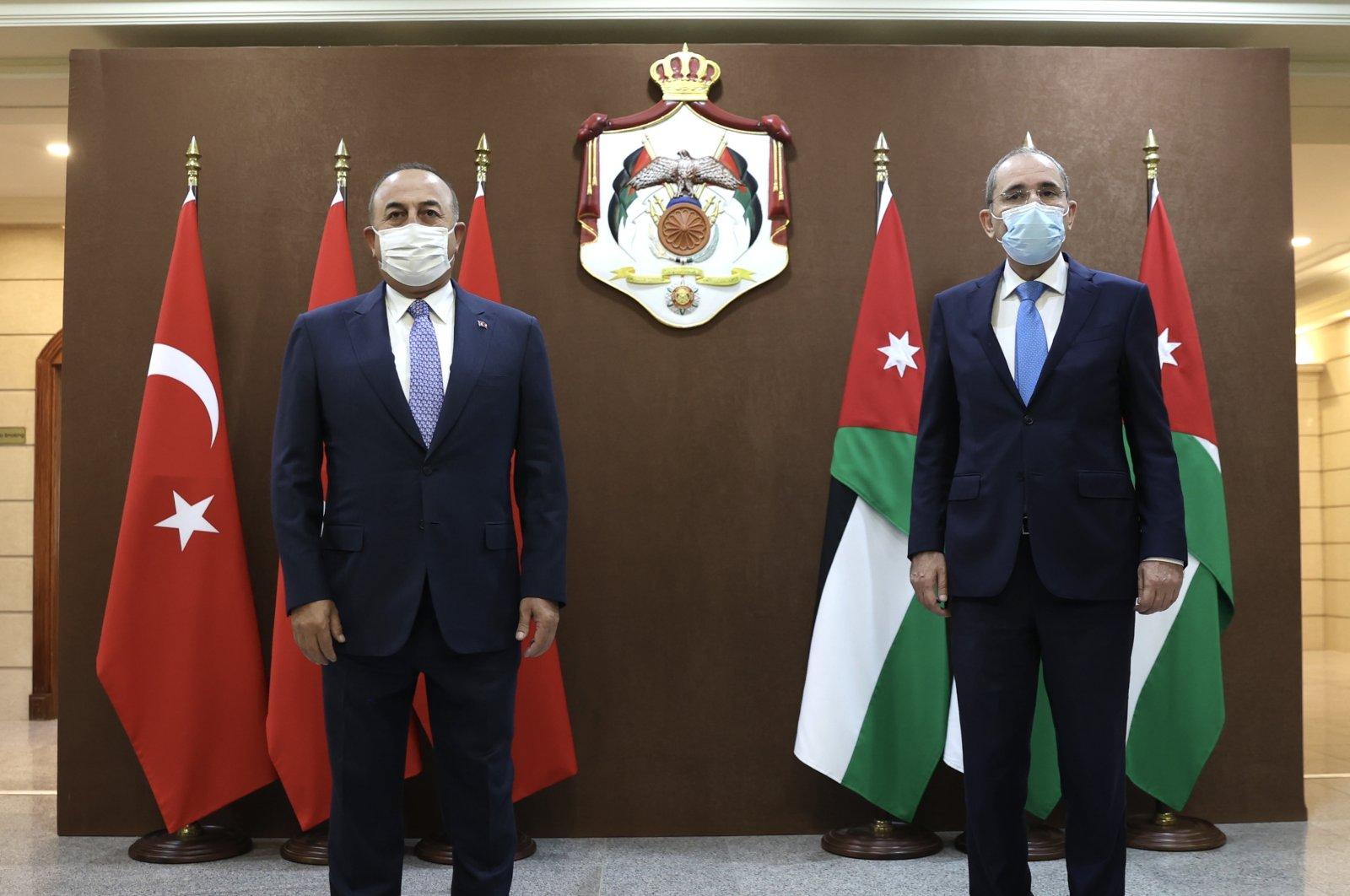 Foreign Minister Mevlüt Çavuşoğlu (L) and his Jordanian counterpart Ayman Safadi meet in Amman, Jordan, Aug. 17, 2021. (AA Photo)