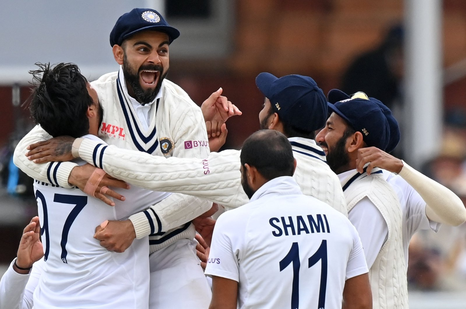 India's captain Virat Kohli (2nd L) celebrates teammates after a successful appeal for the wicket of England's Jonny Bairstow on Day 5 of the second Test at Lord's cricket ground, London, England, Aug. 16, 2021. (AFP Photo)